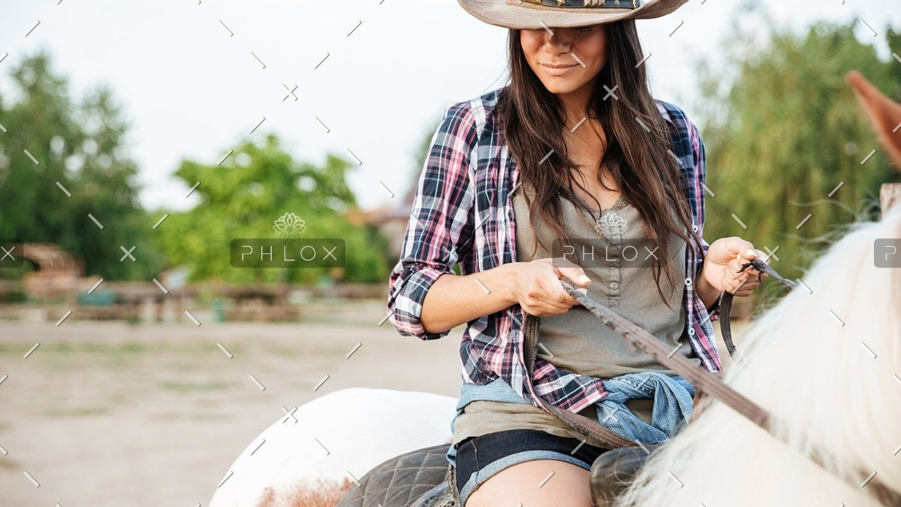 demo-attachment-19-beautiful-young-woman-cowgirl-sitting-and-riding-P3DWVG6