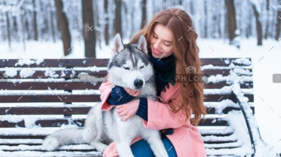 demo-attachment-38-woman-sitting-on-the-bench-with-siberian-husky-PS9ZX58