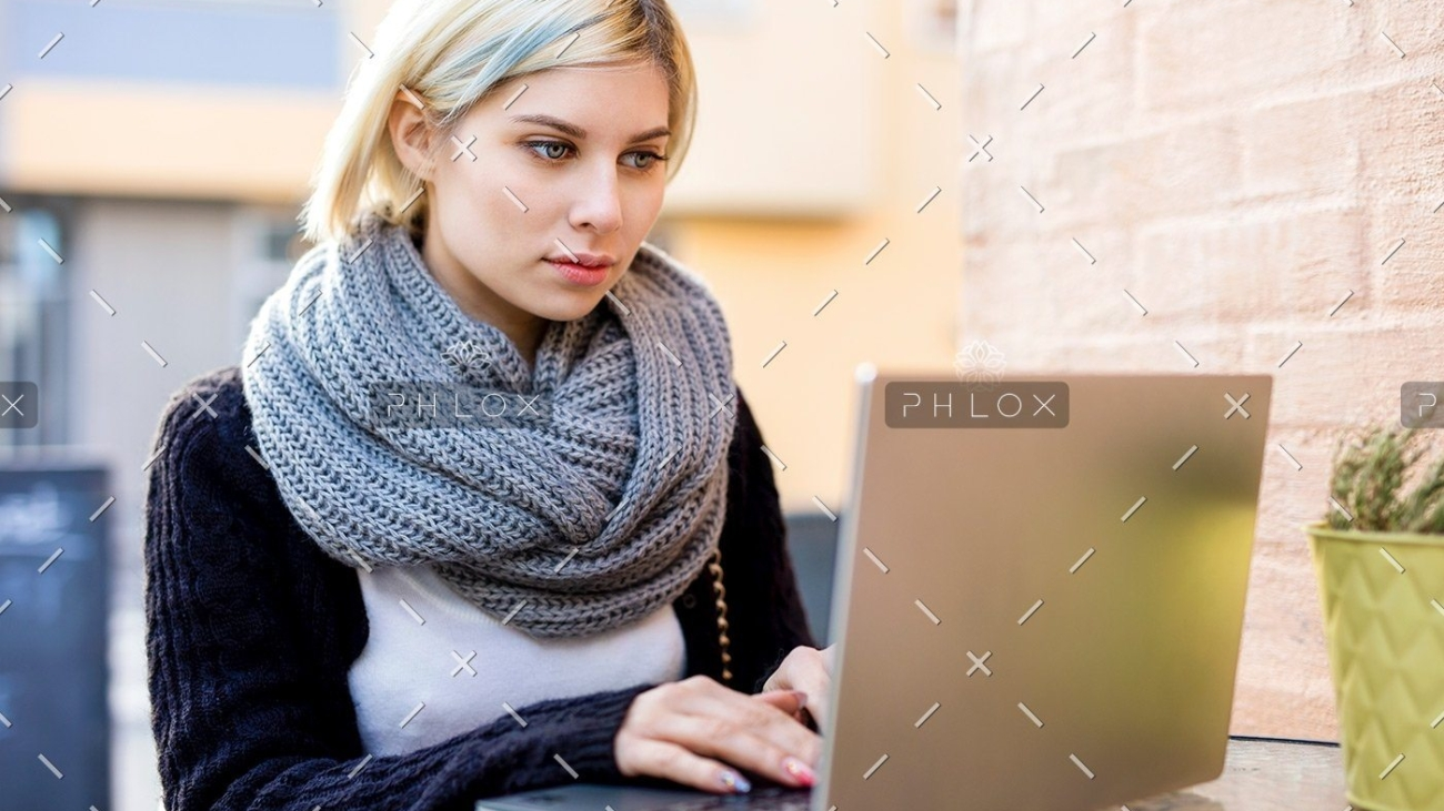 demo-attachment-40-young-focused-woman-working-on-laptop-at-outdoor-PTTFVNE